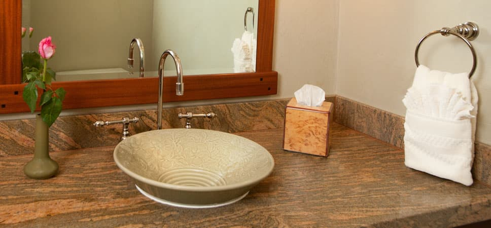 Simple stoneware sink in a muted green with a subtle and delicate floral design