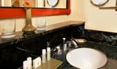 Wash basin with pampering Guest-size soaps, lotions and products