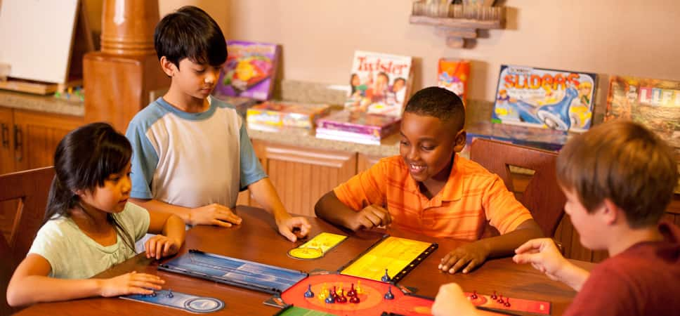4 young Guests play a board game.