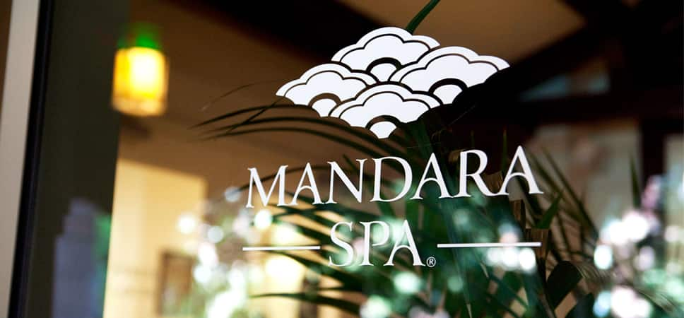 Sign on the glass door: Mandara Spa