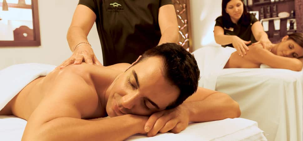 A couple receives a relaxing massage.