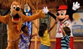 Pluto and Mickey Mouse lead 3 young Guests in morning cheers.