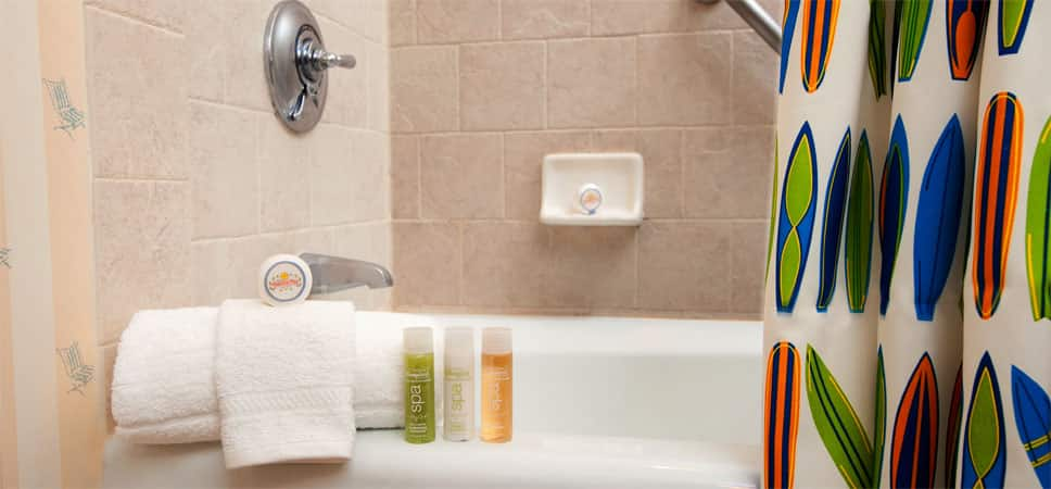 Soap, plush towels and Guest-size bottles of shampoo, conditioner and lotion