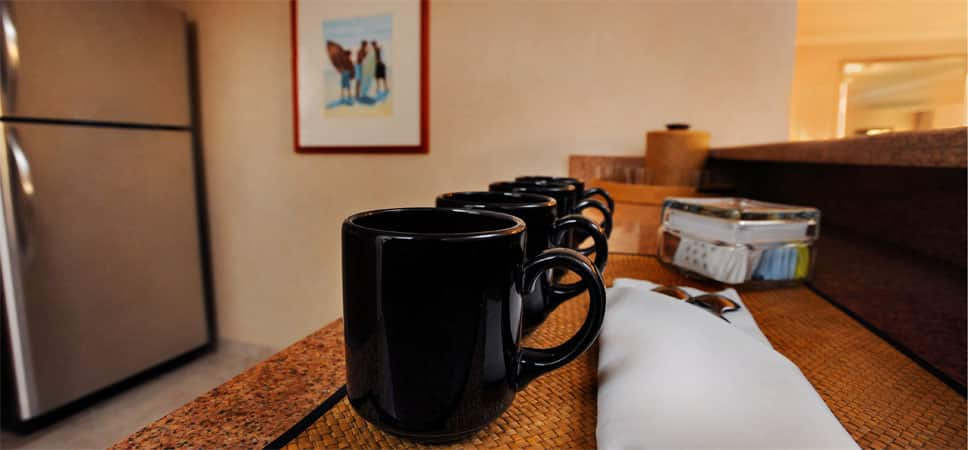 Coffee mugs are lined up on the bar and ready for the morning.