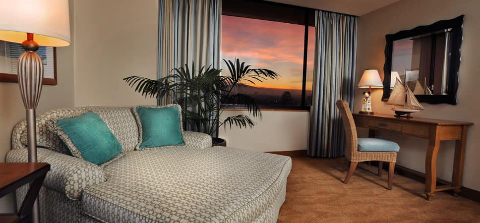 View of the sleeper sofa near the window with a view of the sunset.