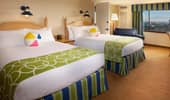 In the room: 2 queen-size beds decorated with beach-ball pillows.