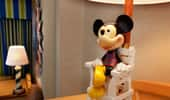 A delightful desk lamp has a base with Mickey Mouse on a life guard's chair.