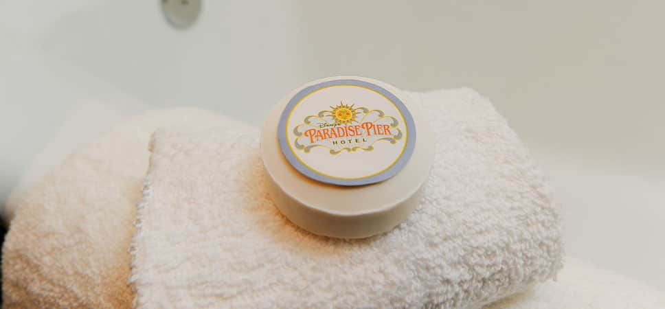 A round bar of Disney's Paradise Pier Hotel rests on a plush washcloth.