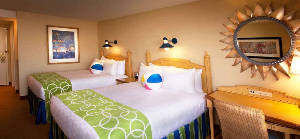 2 queen-size beds and beach-theme decor.