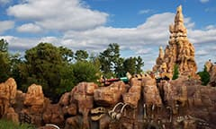 The peak of Big Thunder Mountain looms above the desert landscape of the Big Thunder Mountain Railroad attraction at Disneyland Park