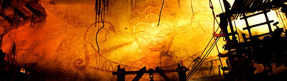 Large, golden, glowing mural of the deity Mara at the Indiana Jones Adventure attraction