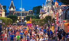Runners stream down Main Street, U.S.A. as they participate in a runDisney event