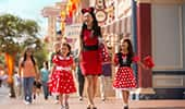 A mother holding hands with her daughters in Hollywood Land at Disney California Adventure Park