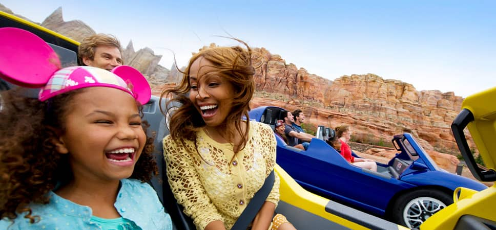Using the Annual Passholder Early Entry benefit, a mom and her daughter start their day laughing on a new Cars Land attraction.