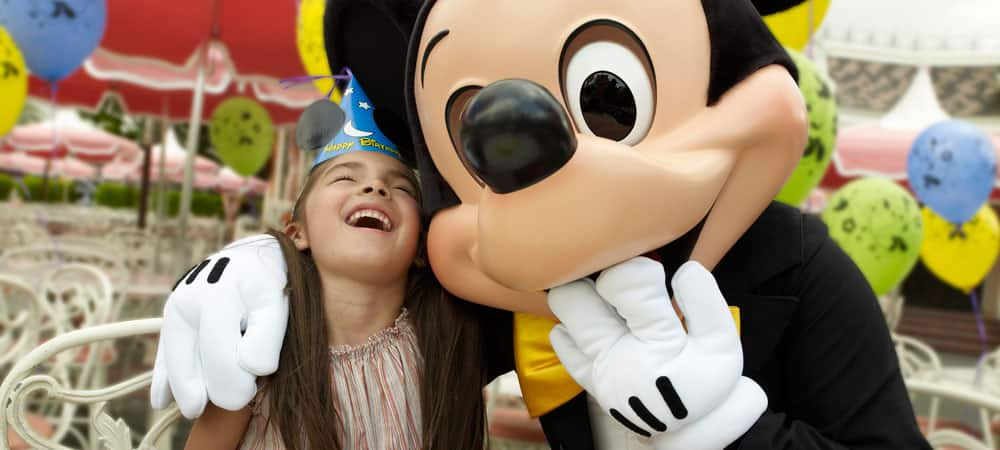 A Girl Laughs with Mickey Mouse