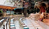 Rows of chairs are set up in front of a stage with a giant tiger head with a mouth like a cave entrance Rows of chairs are set up in front of a stage with a giant tiger head with a mouth like a cave entrance