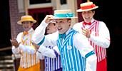 The Dapper Dans barbershop quartet performing in costume