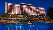 The exterior of Disney's Contemporary Resort and a large swimming pool