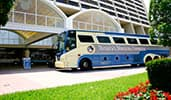 Disneys Magical Express motorcoach near a building