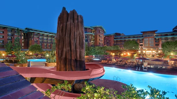 A Tall Rock Formation In Front Of Lighted Pool At Disney S Grand Californian Hotel
