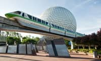 The monorail passing in front of the EPCOT sphere at Walt Disney World