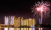 Fireworks surround Bay Lake Tower at Disney's Contemporary Resort, a Disney Vacation Club Resort