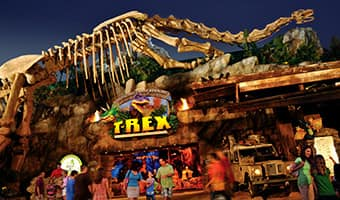 The entrance to T-REX restaurant featuring a giant T-Rex skeleton