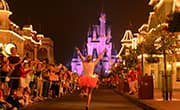 Running down Main Street, U.S.A. toward Cinderella Castle during Disney Princess Half Marathon at Walt Disney World