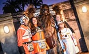 Family of runners pose with Chewbacca during Star Wars Half Marathon - The Light Side event.