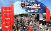 Runners cross the finish line of the Star Wars Dark Side Half Marathon at Walt Disney World.