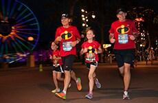 "Runners dressed as ""The Incredibles"" run through Disney California Adventure Park during Disneyland Half Marathon Weekend."