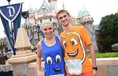 "Runners dressed as characters from ""Finding Nemo"" and ""Finding Dory"" pose in front of Sleeping Beauty Castle at Disneyland Park during Disneyland Half Marathon Weekend."