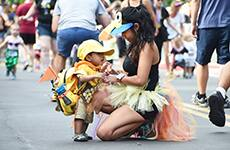 Young runner and parent participate in the runDisney Kids Races during Disneyland Half Marathon Weekend at Disneyland Resort.