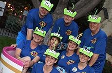 """Runners dressed as Pixar's """"Toy Story"""" aliens participate in Disneyland Half Marathon Weekend."""