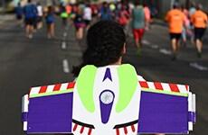 Runner dressed as Buzz Lightyear runs Disneyland Half Marathon.
