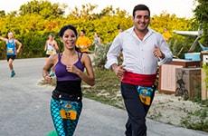 Castaway Cay Challenge participants run the Castaway Cay 5K.