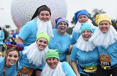 Runners dressed as Snow White and the Seven Dwarfs run through Epcot during Walt Disney World Marathon Weekend.