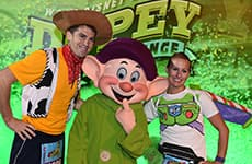 Runners pose with Dopey for the Dopey Challenge during Walt Disney World Marathon Weekend.