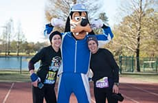 Runners pose with Goofy during the Walt Disney World Marathon.