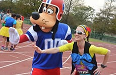 Runner poses with Goofy at ESPN Wide World of Sports Complex during Walt Disney World Marathon.