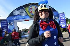 Runner dressed as Donald Duck finishes the Walt Disney World Half Marathon.
