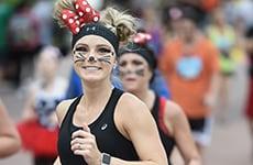 Runner dressed as Minnie Mouse during Walt Disney World Marathon Weekend.