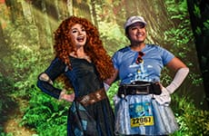 Runner poses with Merida during Disney Princess Half Marathon Weekend.