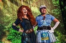 Runner poses with Merida during Disney Princess Half Marathon Weekend.