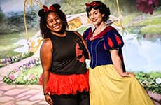 Runner poses with Snow White during Disney Princess Half Marathon Weekend at Walt Disney World Resort.