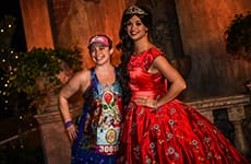 Runner poses with Princess Elena of Avalor during the Disney Princess Enchanted 10K.