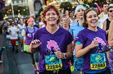 Runners run down Main Street, U.S.A. in Magic Kingdom Park during Disney Princess Half Marathon at Walt Disney World Resort.