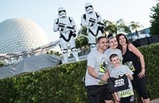 Runners pose with Kylo Ren before the Star Wars 5K during Star Wars Half Marathon – The Dark Side race weekend.