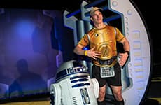 Runner poses with R2-D2 during Star Wars Rival Run Weekend.