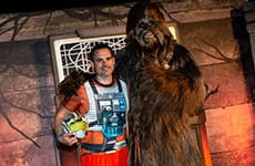 Runner poses with Chewbacca before the Star Wars Rival Run 5K.